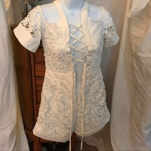 NWOT Lace covered white romper with lace-up back